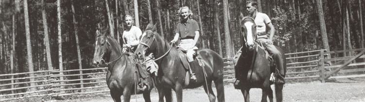 Historic picture of people on horses at Sentinel Pine